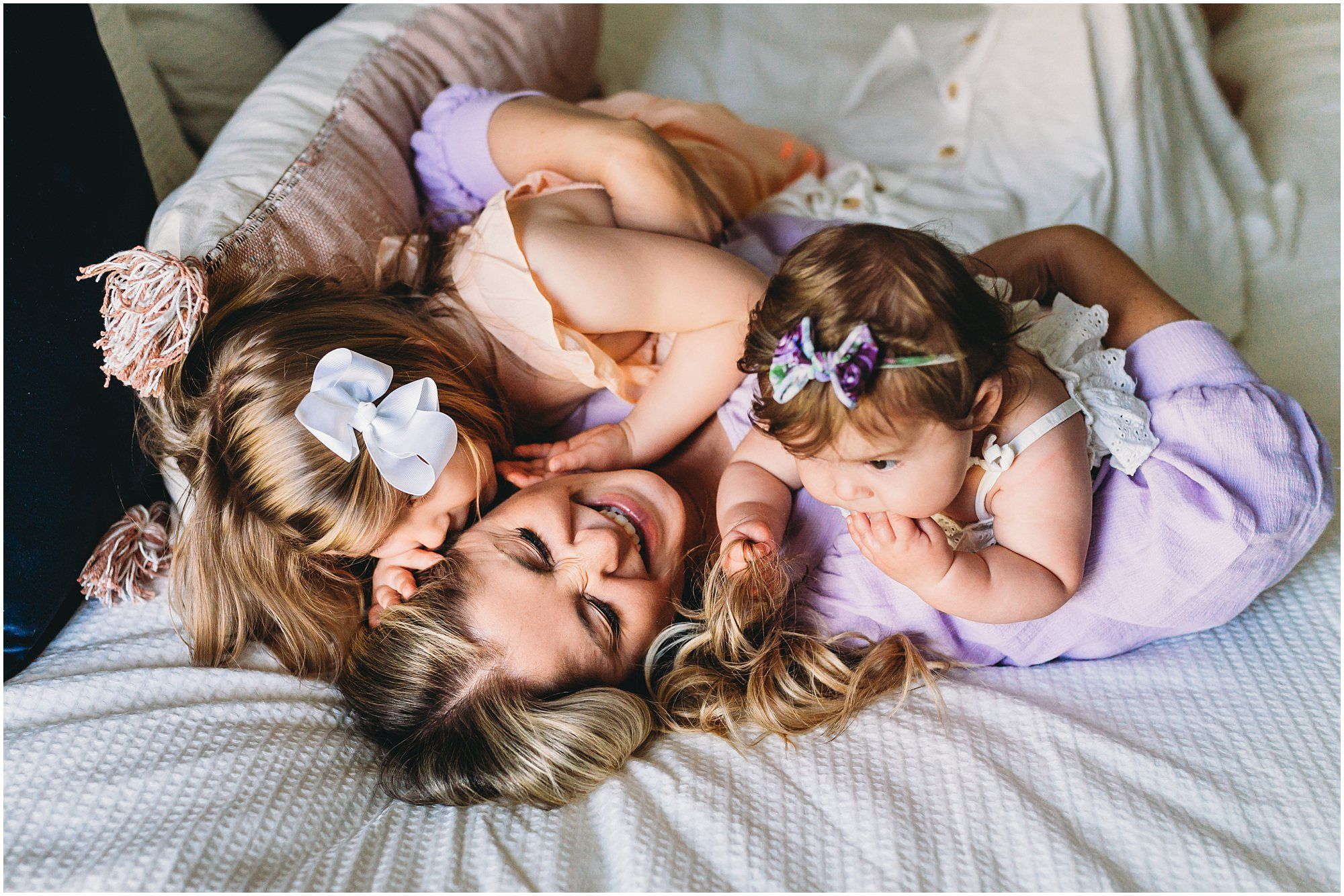 mother and daughters smiling and happy - Sabrina Gebhardt Photography